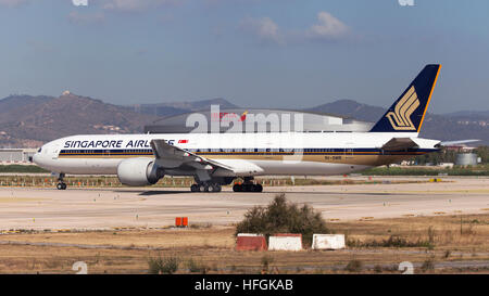 Singapore Airlines Boeing 777-300ER on runway prior to take off from El Prat Airport in Barcelona, Spain. - Stock Photo