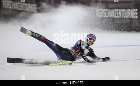 German ski jumper Andreas Wellinger in action during the first round in the run-off area at the 65th Four Hills - Stockfoto