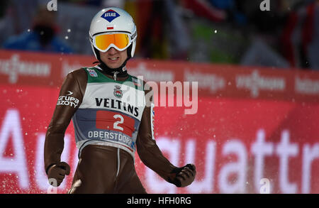 Oberstdorf, Germany. 30th Dec, 2016. Polish ski jumper Kamil Stoch cheering after after his jump in the second round - Stockfoto