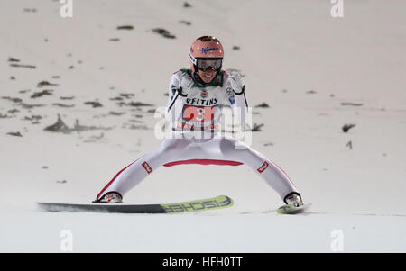 Oberstdorf, Germany. 30th Dec, 2016. Austrian ski jumper Stefan Kraft celebrates after his jump in the second round - Stockfoto