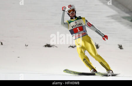 Oberstdorf, Germany. 30th Dec, 2016. Norwegian ski jumper Daniel Andre Tande celebrating after his jump in the second - Stockfoto