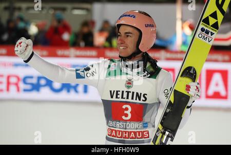 Oberstdorf, Germany. 30th Dec, 2016. Austrian ski jumper Stefan Kraft celebrating after his jump in the second round - Stockfoto