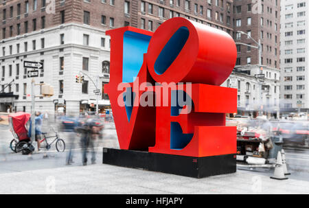 Long exposure shot of the iconic Love pop art sculpture by artist Robert Indiana in New York City - Stock Photo