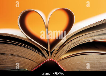 Opened book, pages shaped to form a heart - Stock Photo