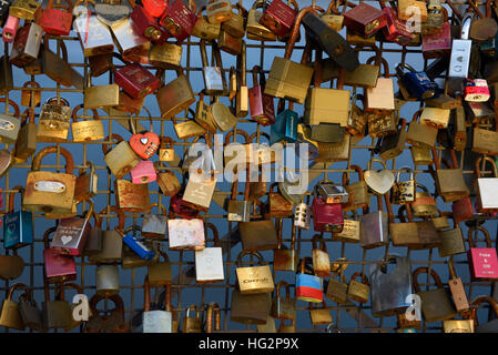 Love locks on Rakkauden Silta Helsinki's Bridge of Love Helsinki Finland - Stock Photo