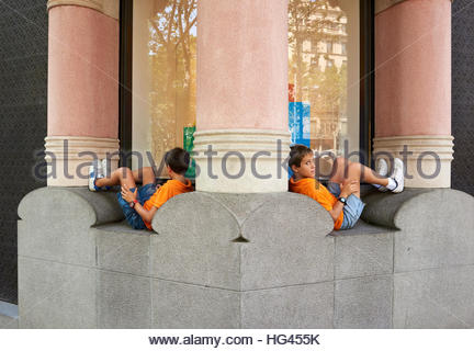 Boy lying down on the Streets in  Barcelona  2016 CREDIT Geraint Lewis - Stock Photo