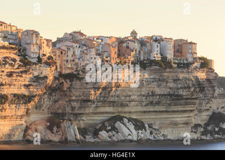 Old citadel townhouses and church at dawn, in early morning light, seen from the sea, Bonifacio, Corsica, France, - Stockfoto