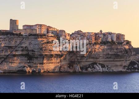 Old citadel at dawn, in early morning light, seen from the sea, Bonifacio, Corsica, France, Mediterranean - Stockfoto