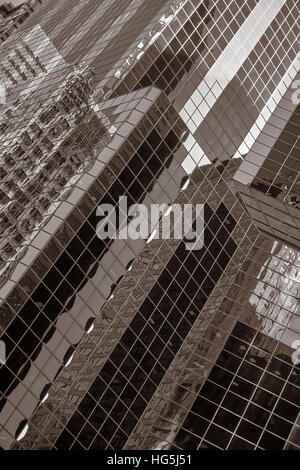 Abstract view of glass skyscrapers reflecting nearby buildings - Stock Photo