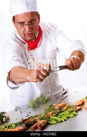 Chef preparing fresh shrimp and green asparagus at the teppan (teppanyaki) - Stock Photo