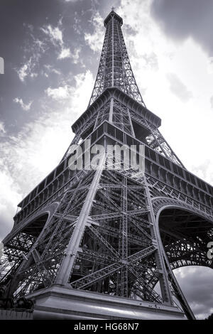 Eiffel tower viewed from the base - Stock Photo