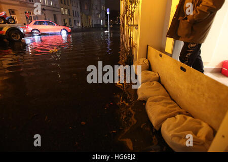 Luebeck, Germany. 04th Jan, 2017. Sandbags stacked in front of a doorway to prevent flooding in Luebeck, Germany, - Stock Photo