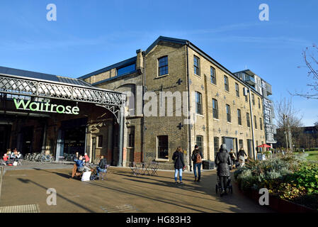 Waitrose in converted building Granary Square Kings Cross with people eating outside, London England Britain UK - Stock Photo