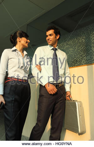 Two business executives walking - Stock Photo