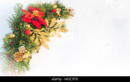 Christmas holiday faux poinsettia pine wreath with white copyspace. - Stock Photo