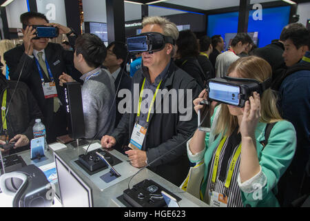 Las Vegas, US. 06th Jan, 2017. Trade fair visitors test Virtual Reality (VR) glasses from South Korean manufacturer - Stock Photo