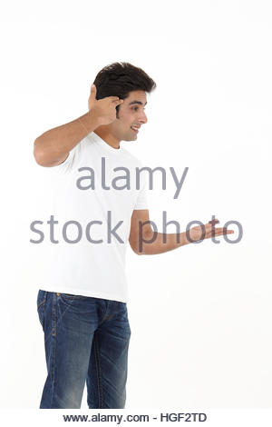Young man making gun with hand pointed at head - Stockfoto