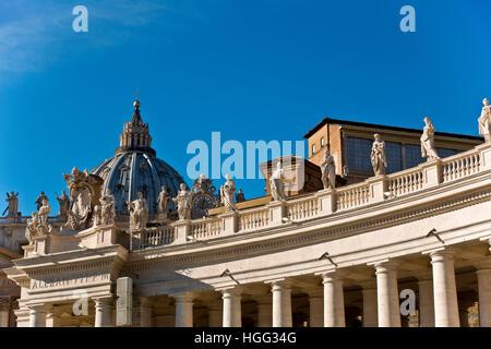 Saint Peter's Square (Piazza San Pietro) colonnade, the dome of the Basilica, Apostolic Palace (Palazzi Vaticani). - Stock Photo