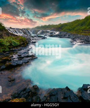Summer sunset with unique waterfall - Bruarfoss. Colorful evening scene in South Iceland, Europe. - Stock Photo