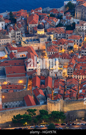 Illuminated Dubrovnik old town in evening from above - Stock Photo