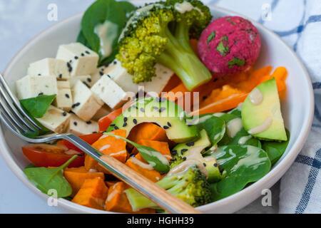 Green vegan salad with broccoli, beetroot and sweet potato falafel. - Stock Photo