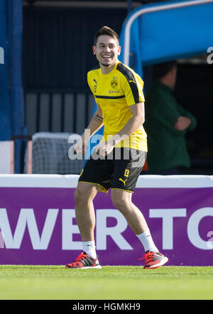 Marbella, Spain. 11th Jan, 2017. Dortmund's Raphael Guerreiro stands laughing on the pitch during training at the - Stockfoto