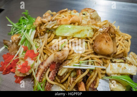 Scallops, squid, seafood grill noodles of Teppanyaki, ate in Kyoto, Japan - Stock Photo