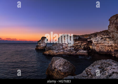 Beautiful sunrise over Rocky ocean beach, Wonderful world Landscape. - Stock Photo