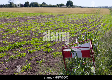 BT barrier around a forgotten hole in a field - Stock Photo