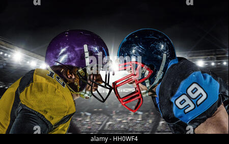 Two american football players fighting for ball. Mixed media - Stock Photo