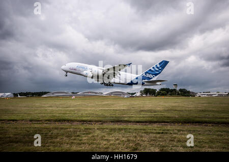 An Airbus A380 displaying at the 2016 Farnborough International Airshow - Stock Photo