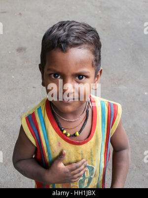 Young boy outside a Temple in Mumbai, India - Stock Photo