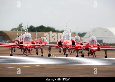 The Royal Air Force Red Arrows aerobatic team taxiing on the runway at RAF Fairford - Stock Photo