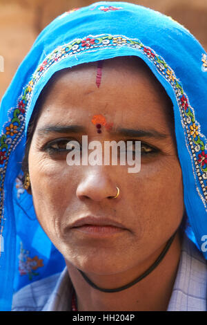 Close up portrait of Rajasthani Traditional Indian woman at a small village in Rajasthan, India - Stock Photo