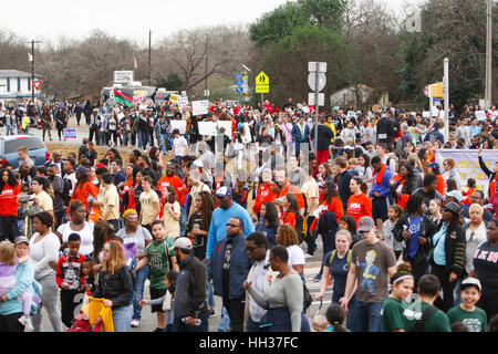 San Antonio, USA. 16th January, 2017. A diverse crowd of marchers walk 2.7 miles in the annual Martin Luther King - Stock Photo