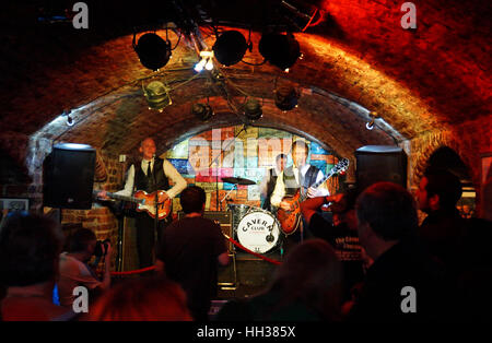 Liverpool, UK. 16th January, 2017. A Beatles tribute band plays in the Cavern Club in Liverpool as it celebrated - Stock Photo