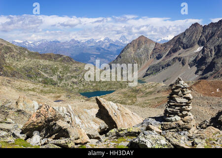 Hiking in Aosta valley, Italy. View of Laures walloon from Laures col. Far away there is Matterhorn. - Stock Photo
