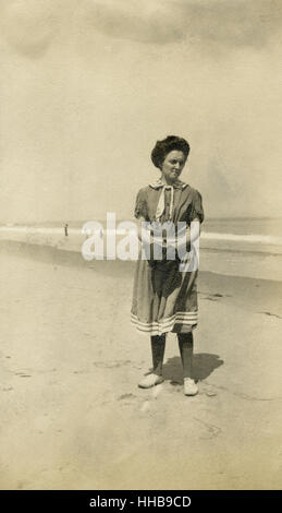 Antique 1908 photograph, woman on beach in Victorian style bathing suit. Location: New England, USA. SOURCE: ORIGINAL - Stock Photo