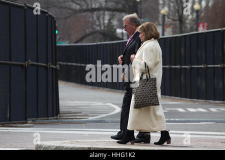 Washington DC, USA. 19th Jan, 2017. A man and woman walk past security barricades along the route of the Inaugural - Stock Photo