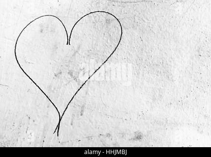 Concept or conceptual painted black abstract heart shape love symbol, dirty wall  background, metaphor to urban - Stock Photo