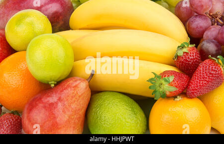 Multicolored background of fruits and berries - Stock Photo