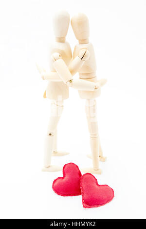 couple embracing in love with two hearts at your feet - Stock Photo