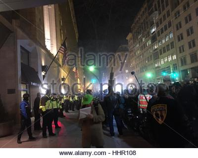 Washington, DC, USA. 19th Jan, 2017. Protesters face tear gas thrown by police as they gather for a demonstration - Stock Photo