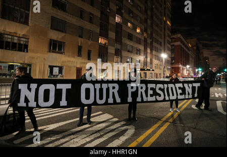 New York, USA. 19th Jan, 2017. People take part in a pre-inauguration demonstration against United States President - Stock Photo