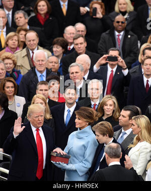 Washington, USA. 20th Jan, 2017. U.S. President Donald Trump(1st L, first row) takes the oath of office during the - Stock Photo