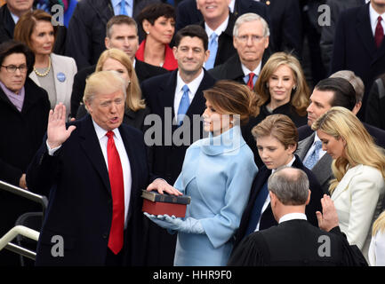 Washington, USA. 20th Jan, 2017. U.S. President Donald Trump(L) takes the oath of office during the presidential - Stock Photo