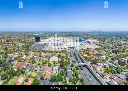 Aerial view of giant shopping mall - Stock Photo