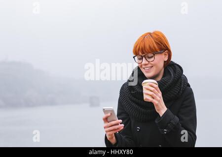 Young modern business woman. Portrait of young girl who checks smartphone. - Stock Photo