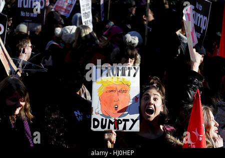 London, UK. 21st Jan, 2017. Protesters hold placards during the Women's March in London, England on Jan. 21, 2017. - Stock Photo