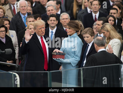 Washington, USA. 20th Jan, 2017. U.S. President Donald Trump takes the oath of office during the inauguration ceremony - Stock Photo